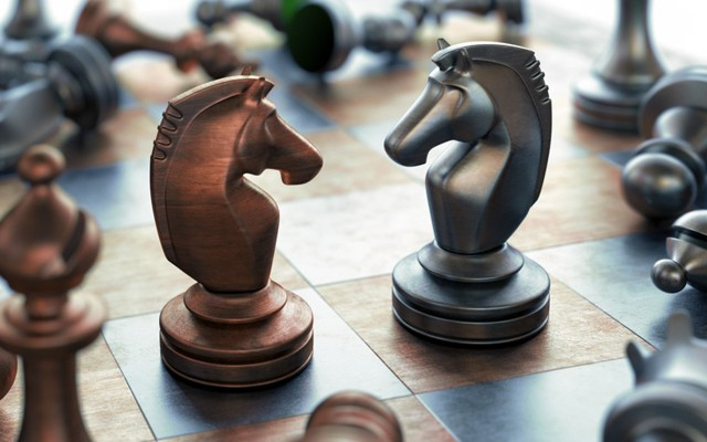 Opposing chess knights facing one another - personality types and conflict